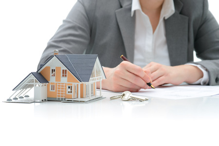 Woman signs purchase agreement for a  house