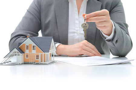 underwrite: Woman signs purchase agreement for a  house