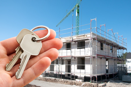 possession: Real estate agent offer keys to new home