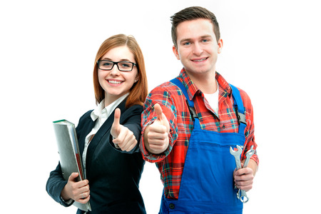 apprenticeship employee: Apprentices for handyman and office showing thumbs up.