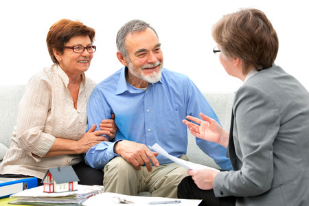 Senior couple meeting with real estate agent photo
