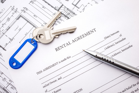 business contract: Rental agreement document with keys and pencil