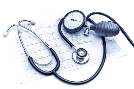pressure gauge: Stethoscope and  blood pressure gauge lying on the ECG chart