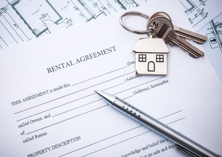 Rental agreement document with keys and pencil photo