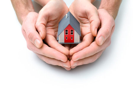 two visions: Human hands holdilg small model of  house Stock Photo