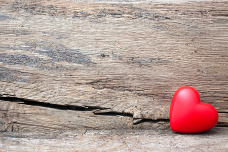 Red heart in crack of wooden plank. Symbol of love, Valentines Day
