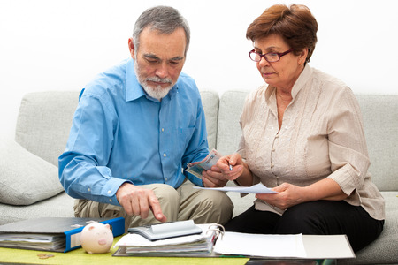 retirement: senior couple worrying about their money situation Stock Photo