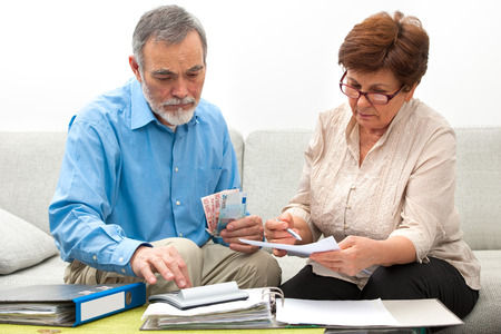 worrying: senior couple worrying about their money situation Stock Photo