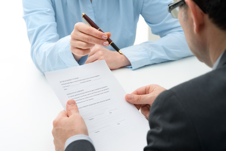 mortgage: Man signs purchase agreement for a  house Stock Photo