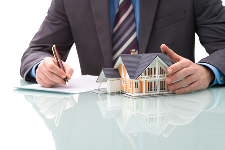 Man signs purchase agreement for a  house Banco de Imagens