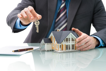 company ownership: Man signs purchase agreement for a  house Stock Photo