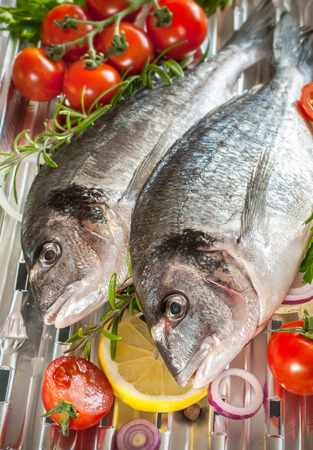 bream: sea bream fish with the vegetables on a grill