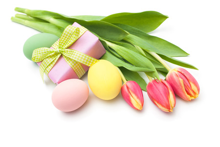 Posy of spring tulips flowers with gift box and Easter eggs isolated on white  photo