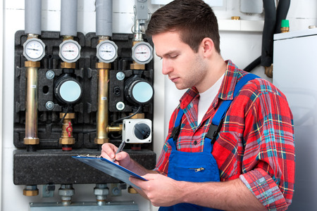 maintenance fitter: Technician servicing the gas boiler for hot water and heating
