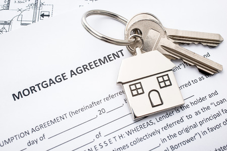 keyring: Mortgage loan agreement application with house shaped keyring