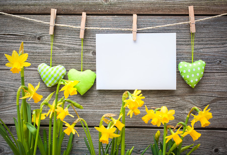 Message and hearts on the clothesline against wooden background photo