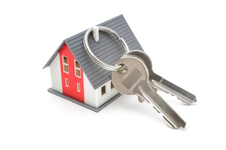 Huis met sleutels, huis kopen, eigendom of het veiligheidsconcept Stockfoto