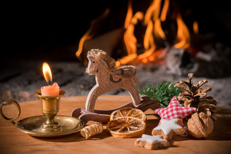Christmas scene with tree gifts, candle and fireplace in background photo