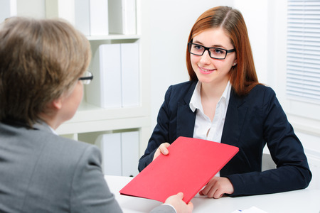 JOB INTERVIEW: smiling woman having job interviews and receiving portfolios