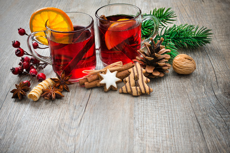 Hot wine for winter and Christmas with orange and spices photo