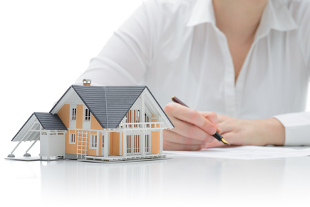 Woman signs purchase agreement for a  house photo