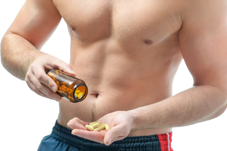 muscle toning: Athletic young man using bodybuilding dietary supplements. Sports nutrition Stock Photo