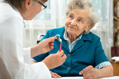 Deaf senior woman during a hearing test photo
