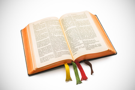an open Bible isolated on a white background photo