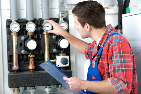 fitter: Technician servicing the gas boiler for hot water and heating