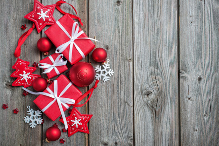 Gift boxes and snowflakes on wooden background