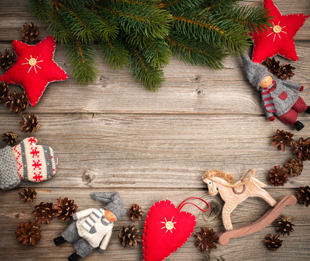 Christmas background with festive decoration and toys over wooden board photo
