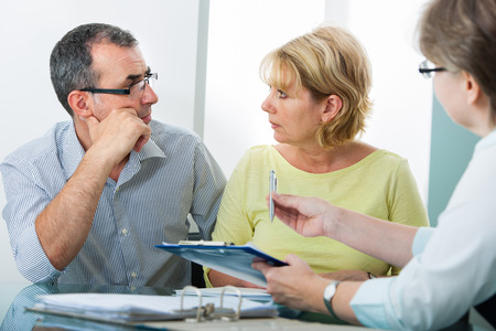 Mature couple getting financial advice from consultant at home Stock fotó