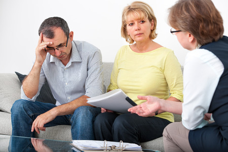 financial guidance: Mature couple getting financial advice from consultant at home Stock Photo