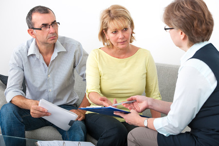 Mature couple getting financial advice from consultant at home Standard-Bild
