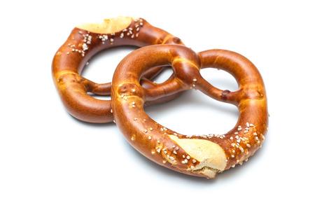 Appetizing bavarian pretzels isolated on white background Imagens
