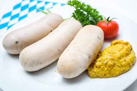 sweet mustard: Bavarian meal. White sausages with sweet mustard on a plate Stock Photo