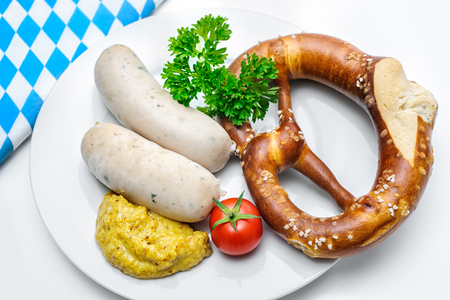 weisswurst: Bavarian meal. White sausages with sweet mustard and pretzels