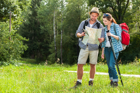 active couple: Happy couple going on a hike together in a forest Stock Photo