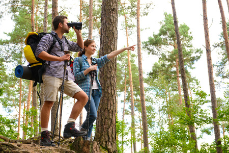 hiking stick: Happy couple going on a hike together in a forest Stock Photo
