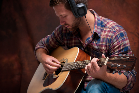 instruments: close up of a male musician playing acoustic guitar Stock Photo