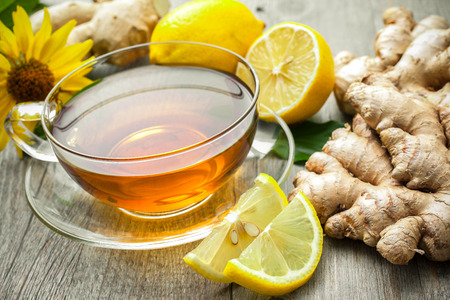 health drink: Cup of ginger tea with lemon on wooden table