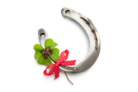 fourleaved: Horseshoes and clover with four leaf on white background Stock Photo