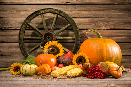 Thanksgiving autumnal still life with old wooden wheel photo