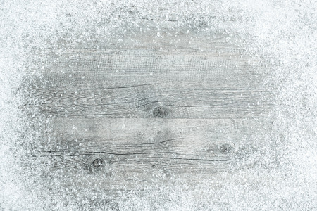 christmas background: Old wooden board with snow flakes . Christmas background