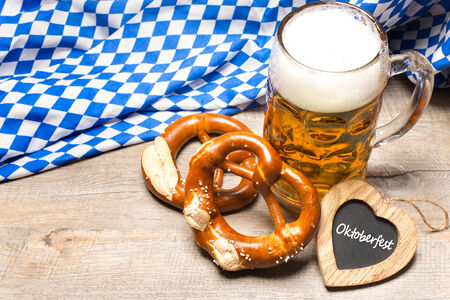 stein: Bavarian beer mug and pretzels on a rustic wooden table