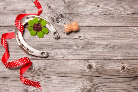 shamrock: Holidays background with horseshoe, shamrock and champagne cork on old wooden