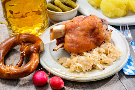 Schweinshaxe (German Pork Knuckle) with pickled cabbage photo