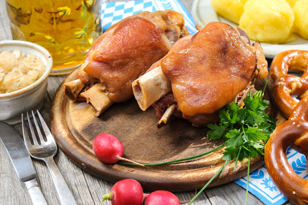 Appetizing Bavarian roast pork knuckle on cutting board Stock Photo