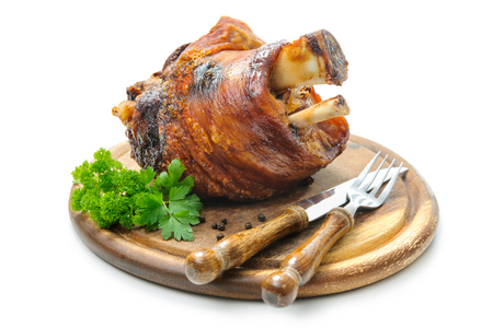 Appetizing Bavarian roast pork knuckle on cutting board Foto de archivo
