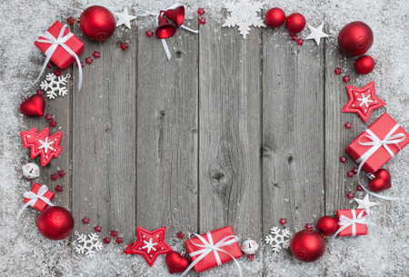 festivity: Christmas background with festive decoration over wooden board Stock Photo
